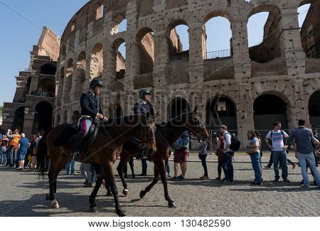 ROME ITALY - APRIL 7: Colosseum was built in the first century AD by the Emperor Vespasian. Policemen on horses patrol near the Colosseum on April 7 2016 Rome Italy.