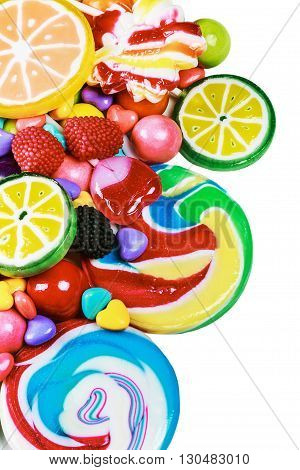 multicolored lollipops candy and chewing gum on a white background