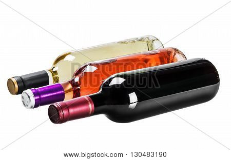 bottles of wine of different types isolated on a white background. focus on red wine in the middle