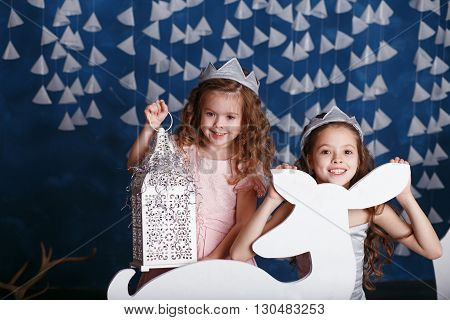 Little Girls In Christmas Decorations.