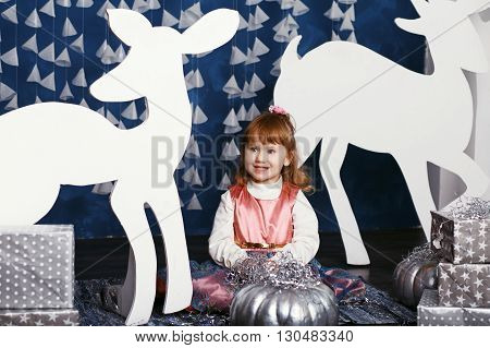 Little Girl In Christmas Decorations.