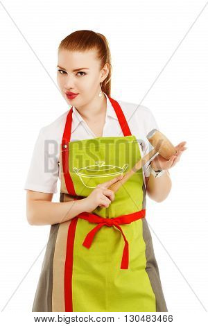 Portrait Of Angry Housewife With A Meat Hammer In Her Hands.