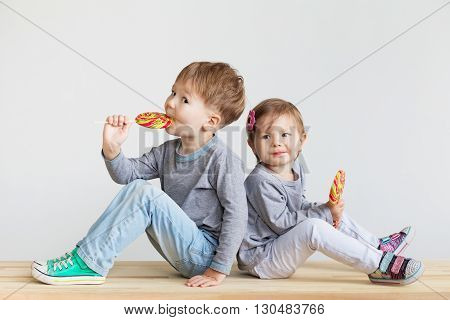 Little Children Eating Lollipops