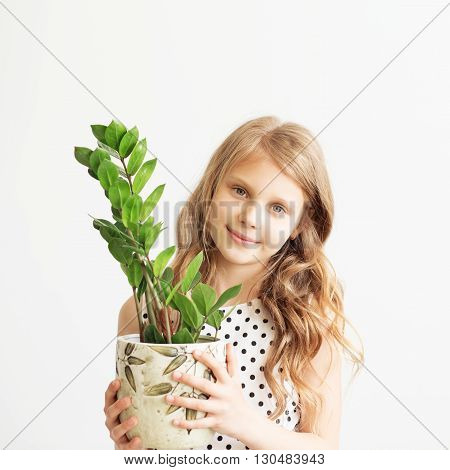 Portrait Of A Lovely Little Girl With Green Houseplant