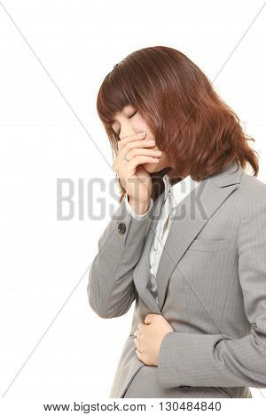 portrait of young Japanese businesswoman feels like vomiting on white background