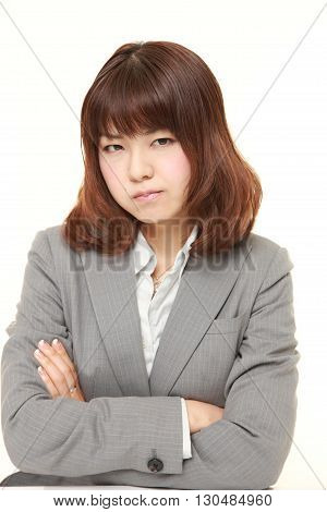 portrait of young Japanese businesswoman in a bad mood on white background