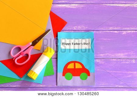 Greeting card with message Happy father's day. Father's day crafts cards ideas suitable for preschool, kindergarten and gradeschool kids. Sheets of paper, scissors, glue on lilac wooden background