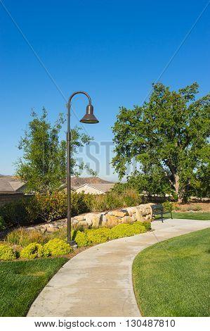 Street Lamp And Park Sidewalk