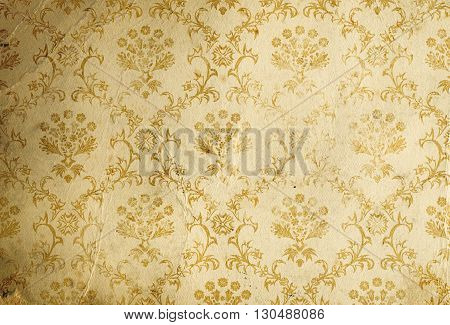 Old dirty and crumpled paper background with old-fashioned floral patterns.