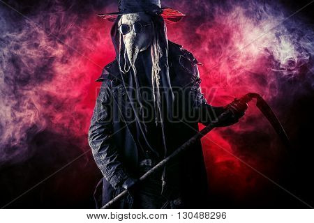 Portrait of a terrible plague doctor with a scythe. Medieval Europe. Halloween.