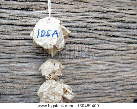 concept creased paper of idea on wooden