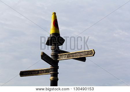 Tourist information sign with traffic cone on top