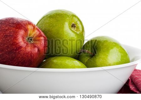Close-up image of apples placed in white dish