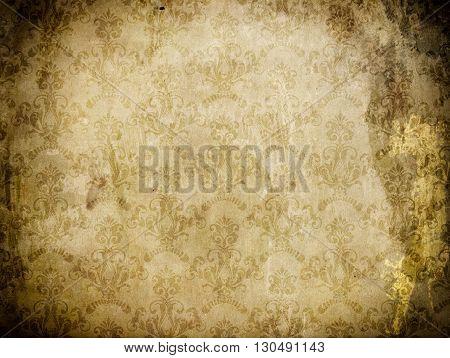Grunge paper background with vintage floral patterns.