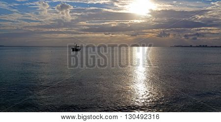 Sunrise over fishing boat in Puerto Juarez Bay in Cancun Mexico