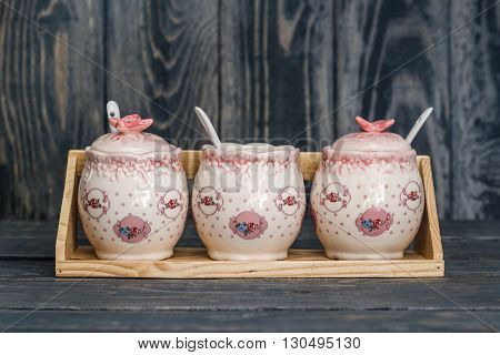 Ceramic Round Jars With Flower Ornaments