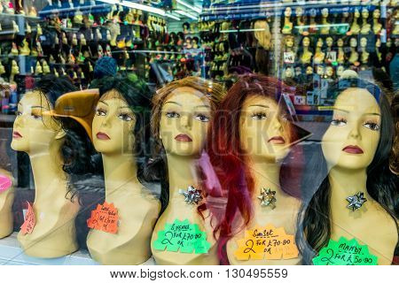 London United Kingdom - May 14 2016: Brixton Village and Brixton Station Road Market. Colorful and multicultural community market run by local traders in South London. Shop with wigs