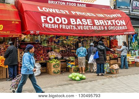 London United Kingdom - May 14 2016: Brixton Village and Brixton Station Road Market. Colorful and multicultural community market run by local traders in South London. Fresh fruits and vegetables shop