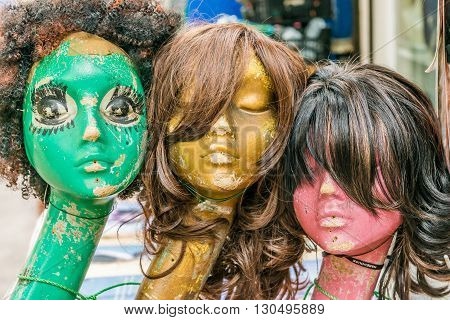 London United Kingdom - May 14 2016: Brixton Village and Brixton Station Road Market. Colorful and multicultural community market run by local traders in South London. Long neck old head mannequins