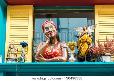 London United Kingdom - May 14 2016: Brixton Village and Brixton Station Road Market. Colorful and multicultural community market run by local traders in South London. Bar window with African lady and an angel
