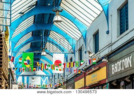 London United Kingdom - May 14 2016: Brixton Village and Brixton Station Road Market. Colorful and multicultural community market run by local traders in South London.