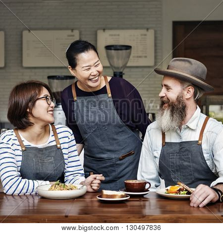 Family Eating Breakfast Together Coffeehouse Concept
