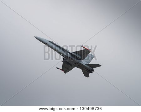 Jet aircraft in flight in dark sky