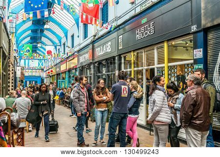 London United Kingdom - May 14 2016: Brixton Village and Brixton Station Road Market. Colorful and multicultural community market run by local traders in South London. Restaurants