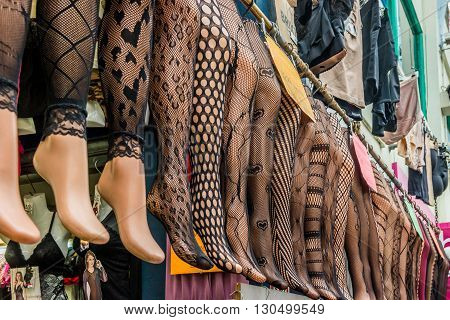 London United Kingdom - May 14 2016: Brixton Village and Brixton Station Road Market. Colorful and multicultural community market run by local traders in South London. Tights and stockings