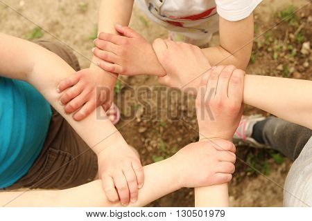 a many  hands a group of children