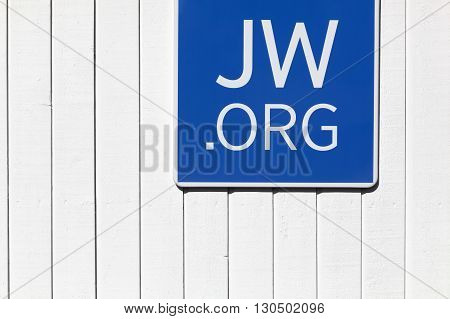 Skejby, Denmark - May 16, 2016: Sign on a wall outside a Jehovah's witnesses kingdom hall. Founded in the 1870s in the USA, the Jehovah's witnesses currently has over 8 million members