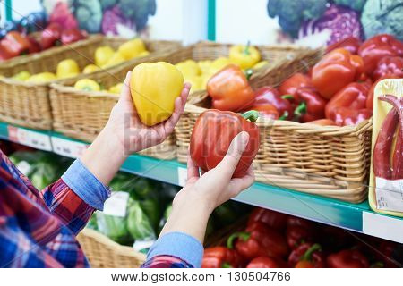Buyer Selects Bell Peppers In Store