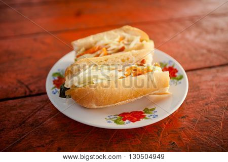Fresh made khmer style baguette with green papaya. Traditional cambodian cuisine.