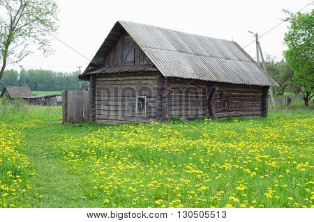 old wooden house stands alone in the abandoned village people