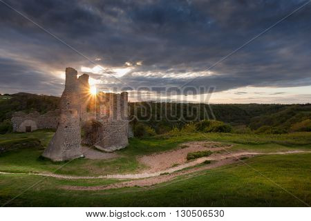 Sunset over the remains of Pennard castle on the Gower peninsula, overlooking Three Cliffs Bay, Swansea.