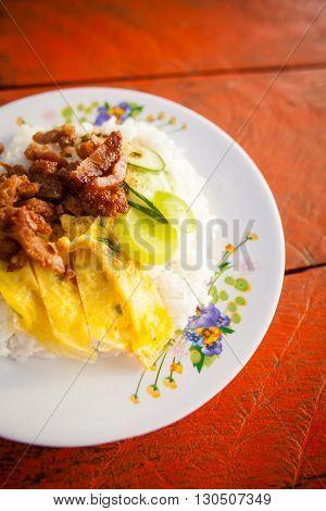 Fresh fried dried pork served with egg omelette. Traditional khmer cuisine.