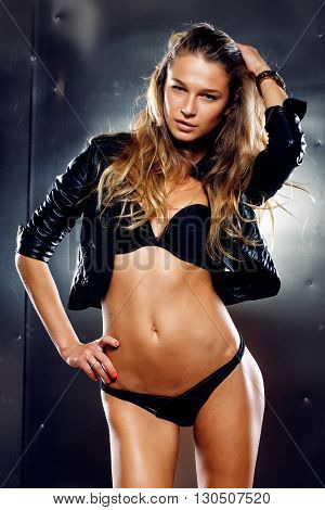 Beautiful woman in lingerie and black leather jacket