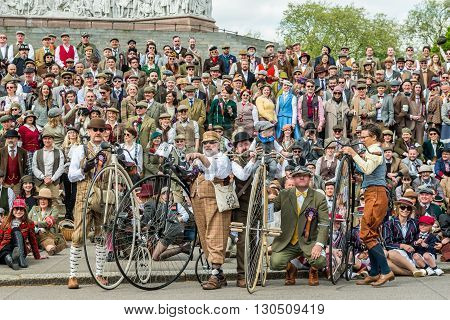 London United Kingdom - May 14 2016: Tweed Run (bicycle ride with a style) at picnic near Albert Memorial in Kensington Gardens Hyde Park. Group photo
