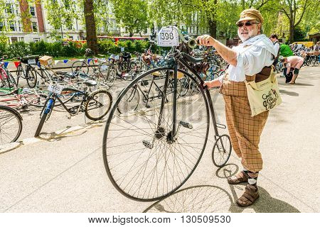 London United Kingdom - May 14 2016: Tweed Run (bicycle ride with a style) at picnic near Albert Memorial in Kensington Gardens Hyde Park. The penny-farthing also known as a high wheel bicycle