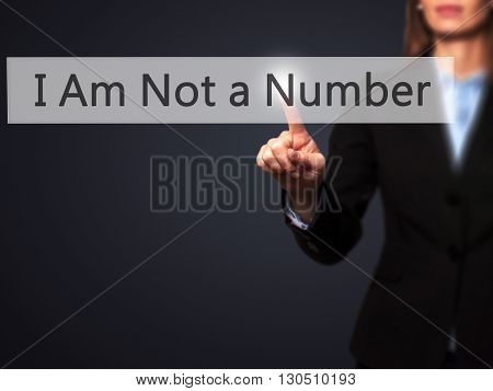 I Am Not A Number - Businesswoman Hand Pressing Button On Touch Screen Interface.