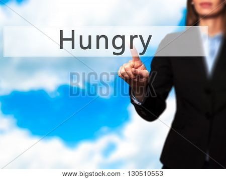 Hungry - Businesswoman Hand Pressing Button On Touch Screen Interface.