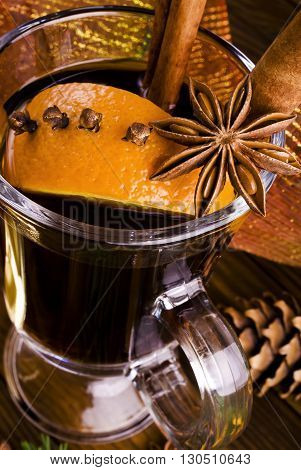Hot spiced mulled wine garnished with orange.