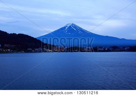 Beautiful Mount Fuji with Kawaguchiko lake in Japan on rainy day at evening.