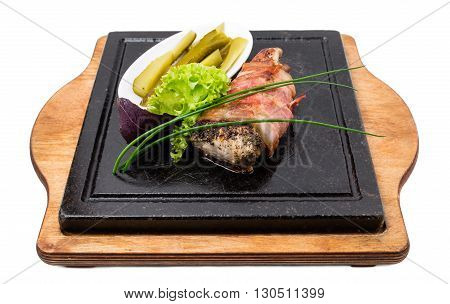 Grilled pork tenderloin in bacon stuffed with herbs and garlic. Isolated on a white background.