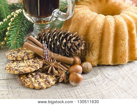 Hot spiced mulled wine garnish with Christmas cookies, nuts and anise