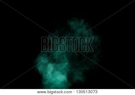 Aquamarine powder explosion on black background. Colored powder cloud. Colorful dust explode. Paint Holi.