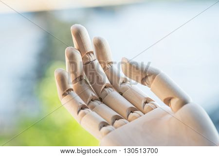 Artificial Wooden Hand On A Wooden Table