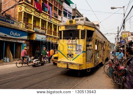 KOLKATA, INDIA - JAN 15, 2013: Traditional tram downtown Kolkata at the bright day on January 15, 2013. Kolkata is the only Indian city with a tram network which is operated by the Calcutta Tramways Comp.