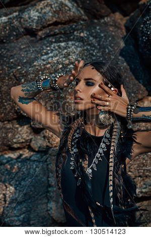 Atrractive young tribal woman in ethnic jewelry portrait outdoors