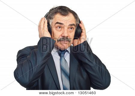 Mature Corporate Man Listening Music